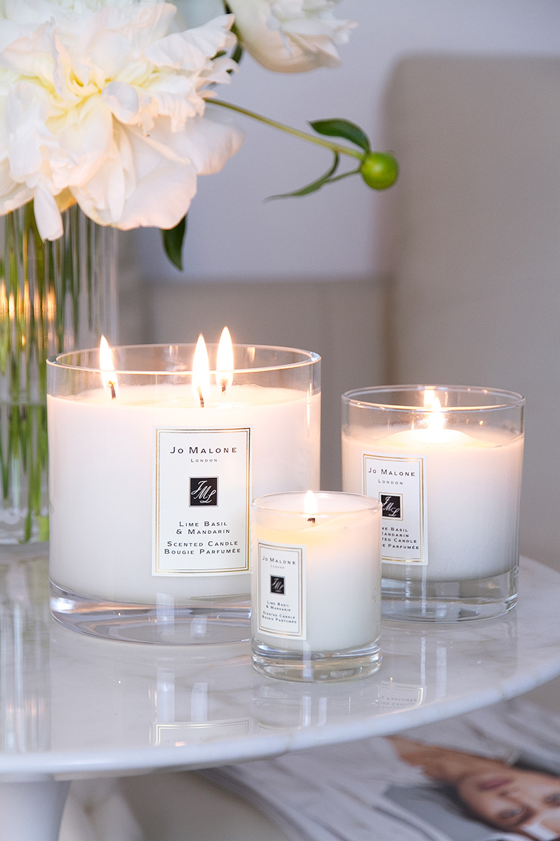 Jo Malone London, living in a scented home, three scented candles, a vase with white peonies flowers on the table