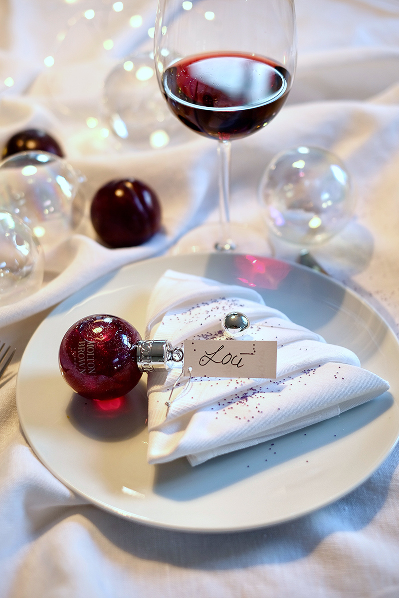 Molton Brown, Muddled Plum, Festive Bauble, Christmas Table, plate, table napkin, glass of red wine