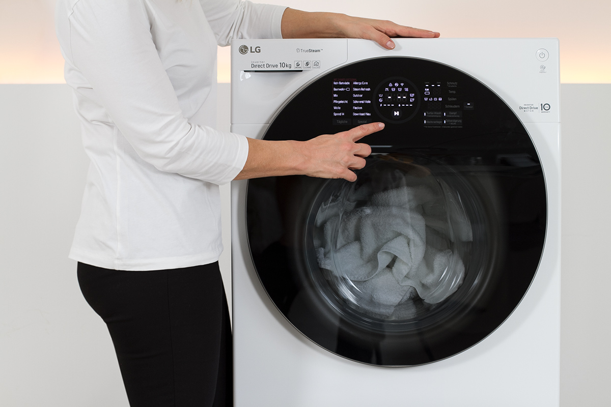 women starting a washing machine, washer, picture from LG TwinWash blog post on lifetime-pieces.com
