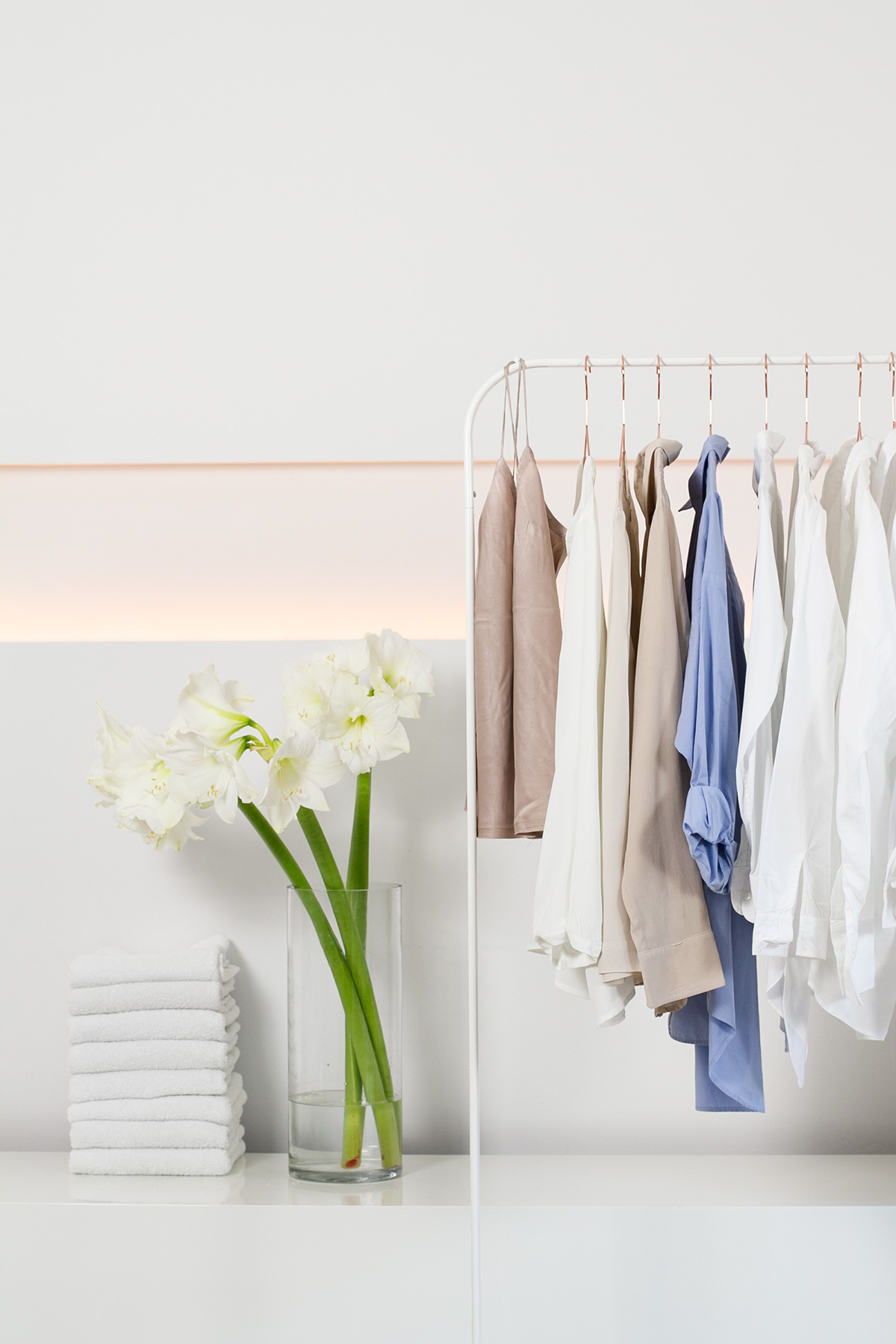 laundry, white flowers, white towels, clotheshorse with white, nude and light blue shirts, picture from LG TwinWash washer blog post on lifetime-pieces.com