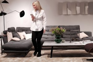 Grand Sofà grey by Antonio Citterio, marble coffee table, woman, stand exhibitor Vitra at imm cologne fair 2018, blog post lifetime-pieces.com