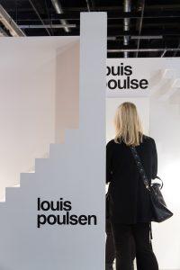 woman at Louis Poulsen stand, imm cologne trade fair 2018, blog post lifetime-pieces.com