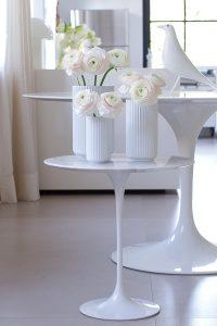 pink peonies in lybngby porcelain vases, spring flowers, white Eames house bird, Saarinen tables, blogpost Lifetimepieces.com