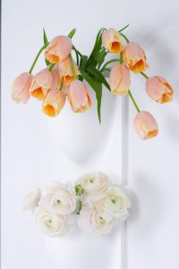 peonies and tulips in VertiPlants vases on the wall, spring flowers, blogpost Lifetimepieces.com