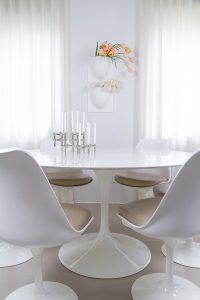 peonies and tulips in VertiPlants vases on the wall, spring flowers, Saarinen table and tulip chairs, justright candle holder,. blogpost Lifetimepieces.com