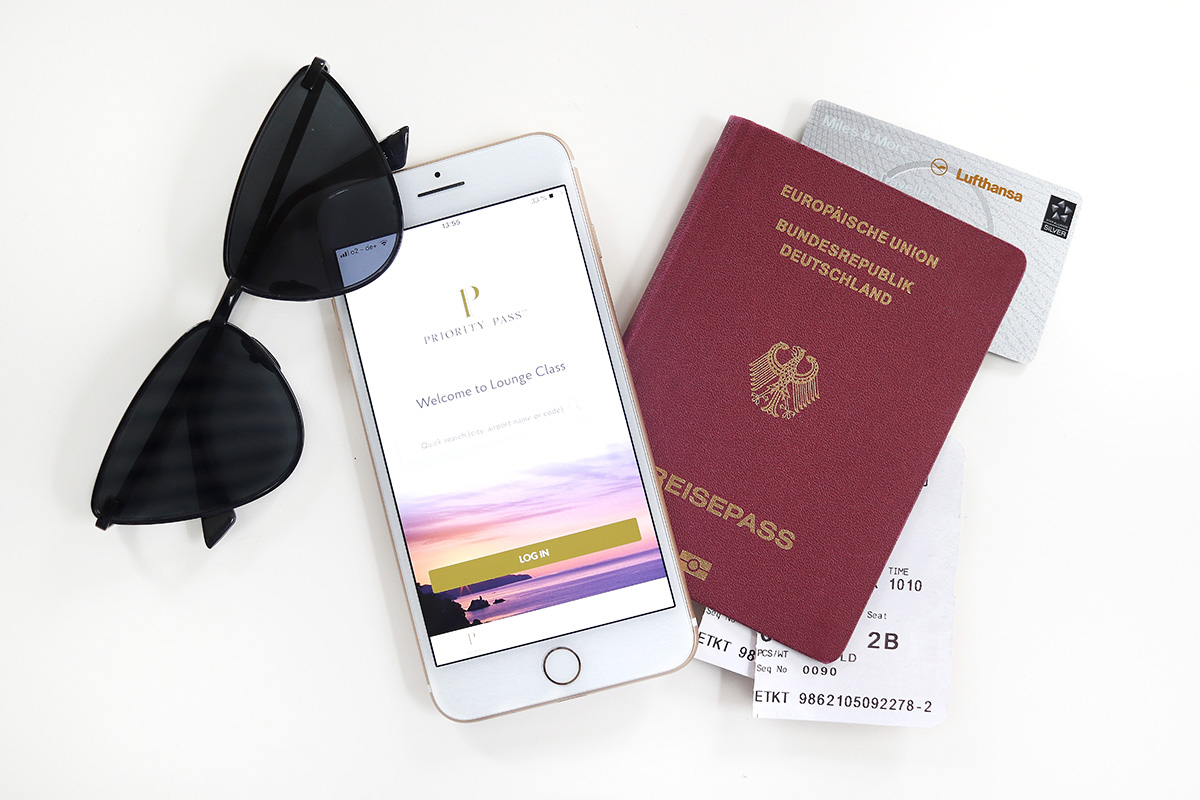 German passport, miles&more card, priority pass, sunglasses, blog post about long-haul flights on Lifetime-pieces.com