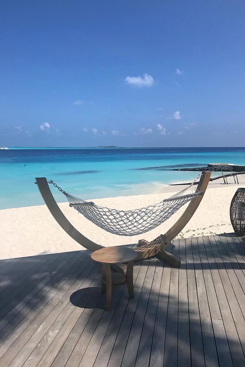 Fushifaru, hammock, Indian Ocean, sea, water villa, beach, sand blue sky, white clouds, blog post about Maldives on lifetime-pieces.com
