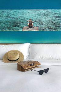 Kandima, room, bed, white linen, straw hat, beach bag, black cat eye sunglasses, blog post about Maldives on lifetime-pieces.com