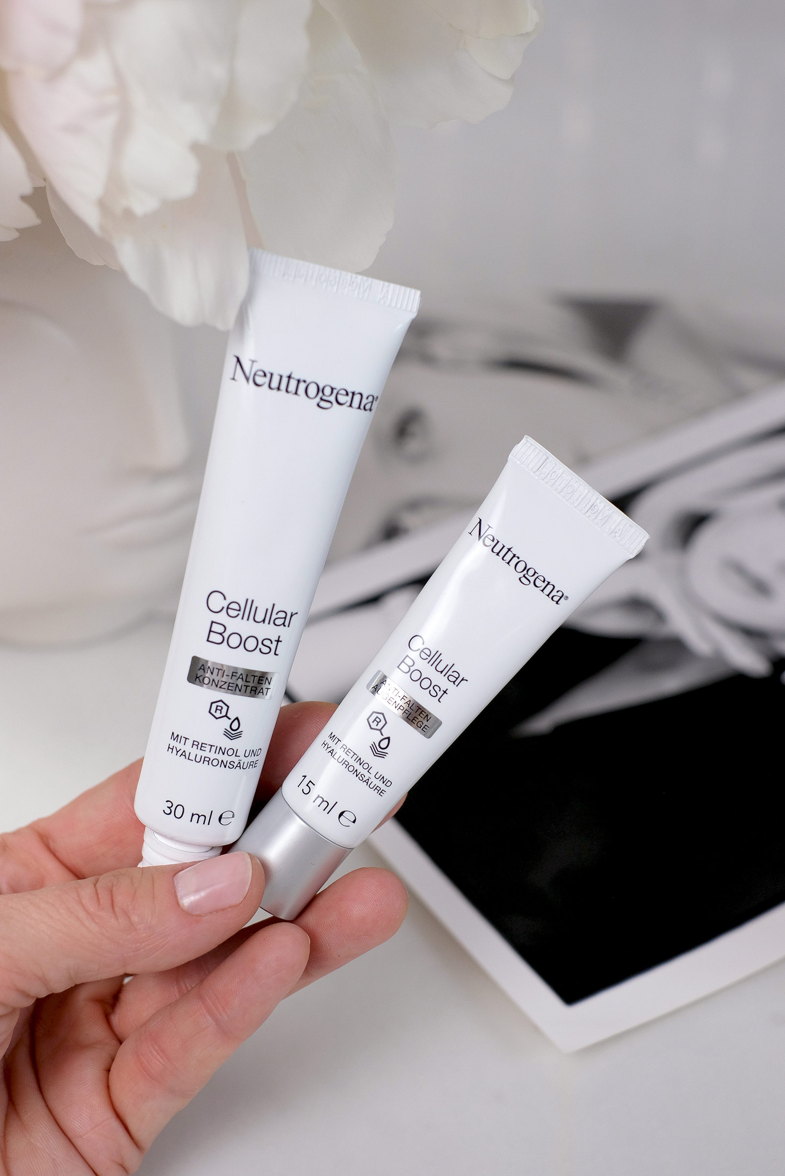 neutrogena, cellular boost, product, skincare, holded by a hand