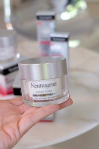 neutrogena, cellular boost, night care product, skincare, holded by a hand